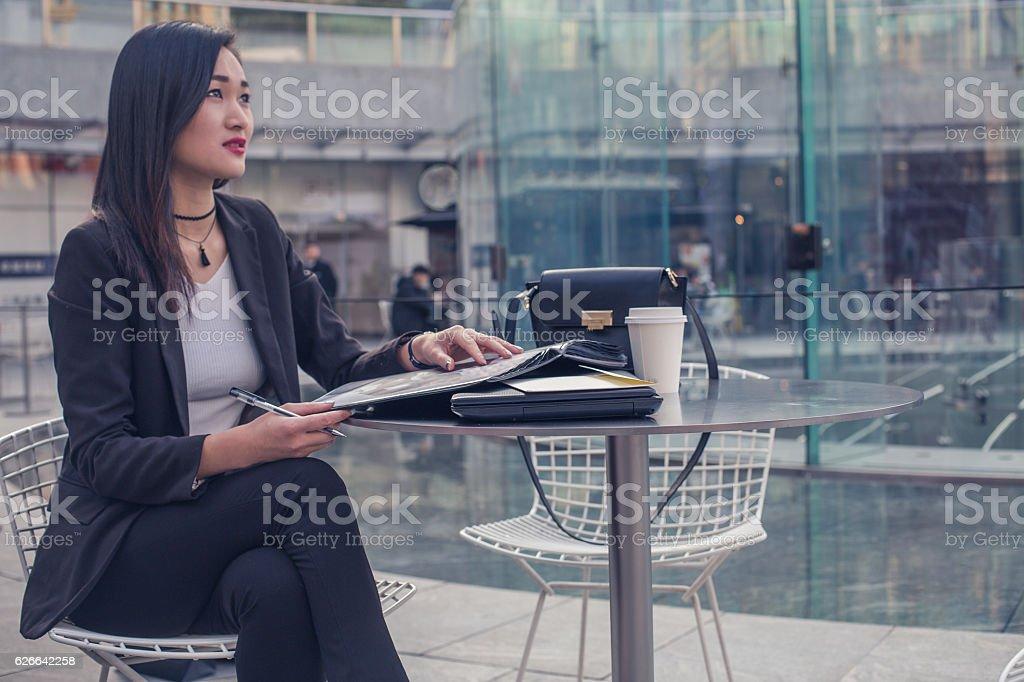 Young secretary finishing work stock photo
