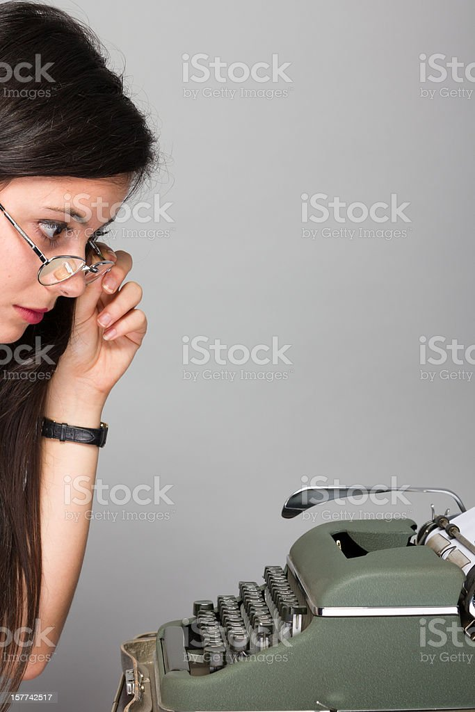Young secretary with old-fashioned typewriter stock photo