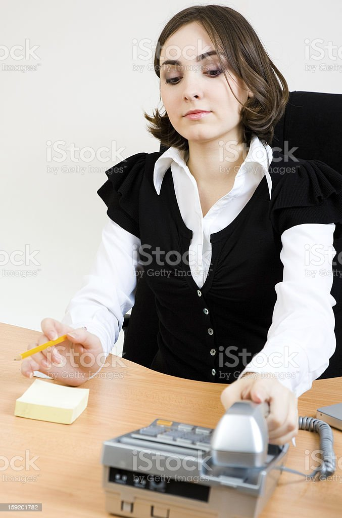 Young secretary with  telephone and pencil stock photo