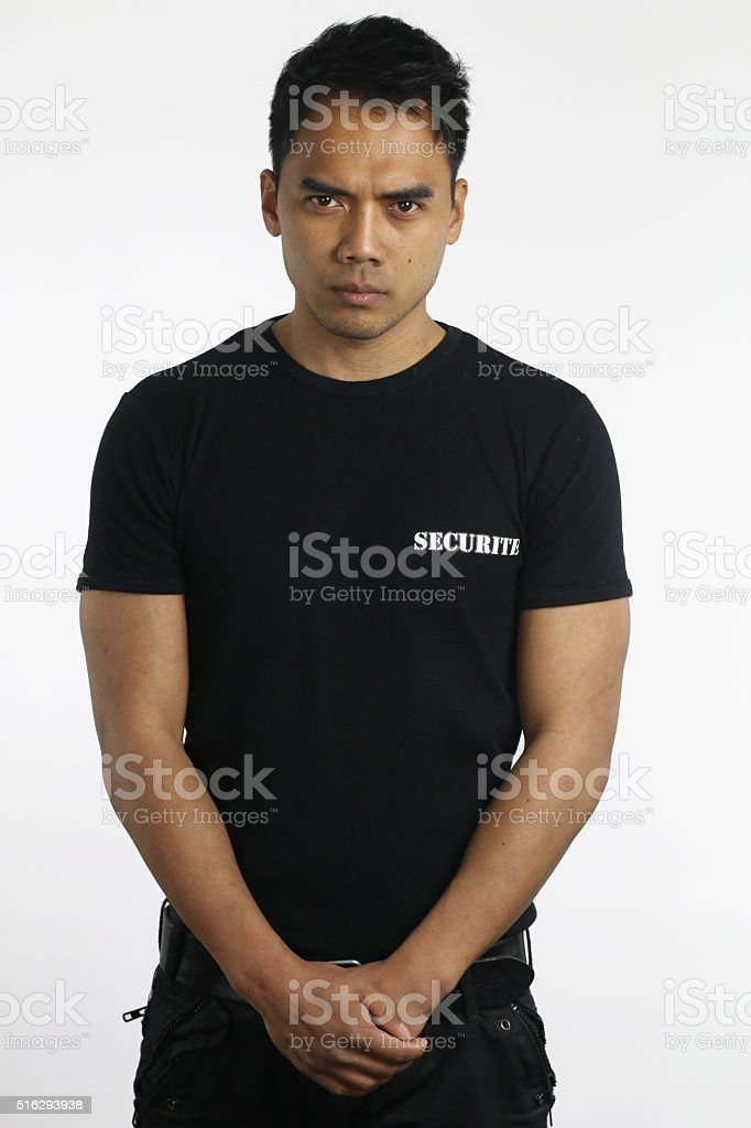 young security guard stock photo