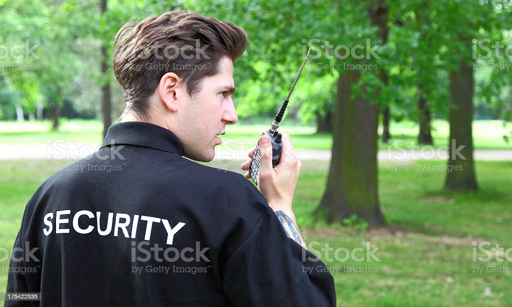 young security officer with walkie-talkie stock photo