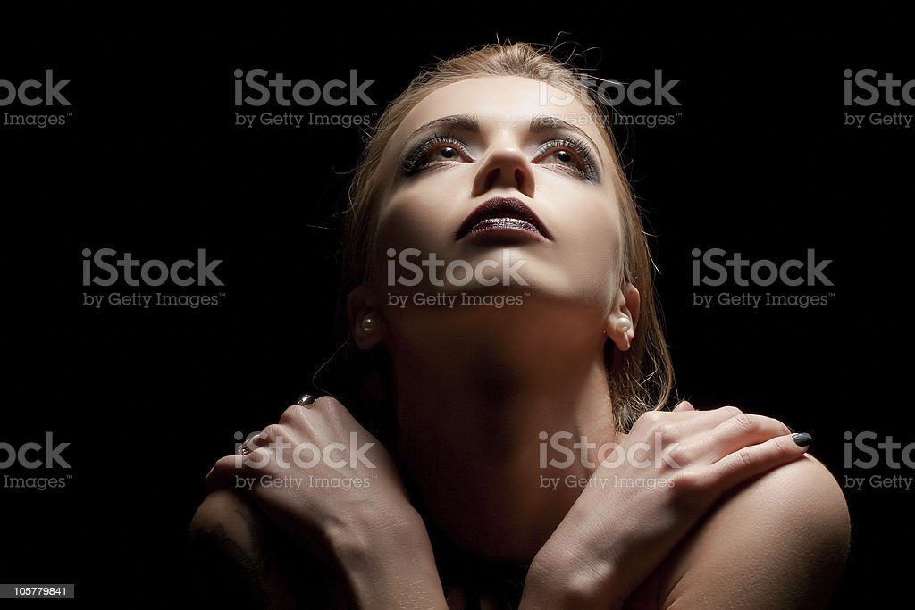 Young sensual woman in ray of light royalty-free stock photo
