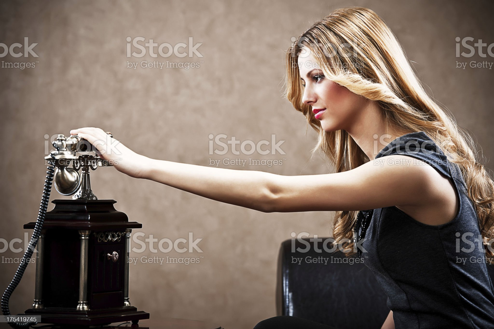 Young sensuality girl picking up telephone. royalty-free stock photo