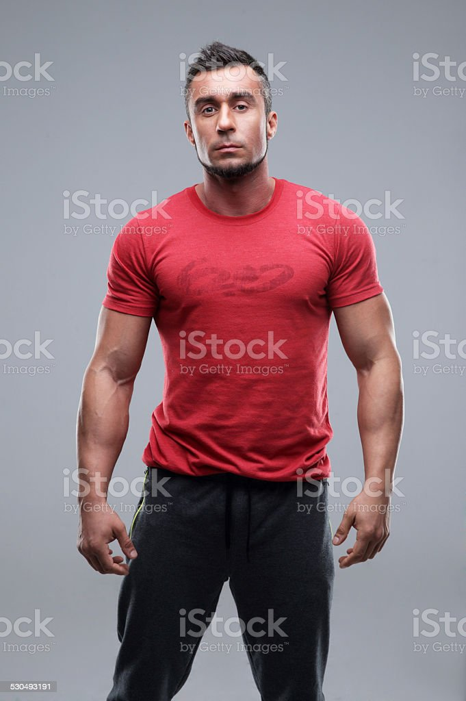 young serious man in red t-shirt stock photo