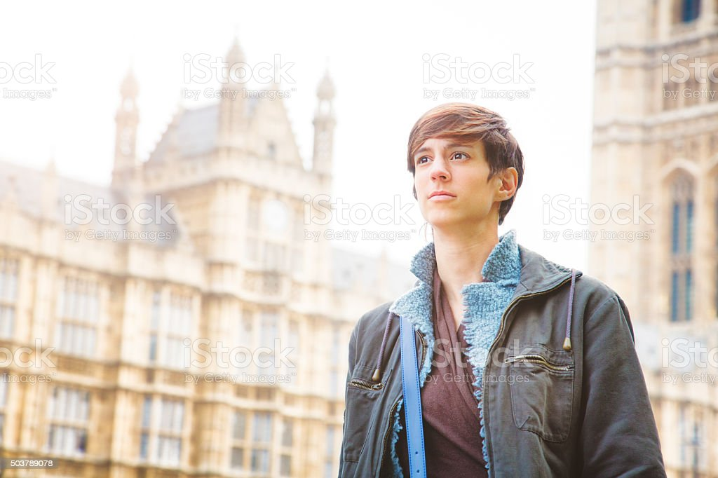 Young serious woman walking in Westminster London UK stock photo