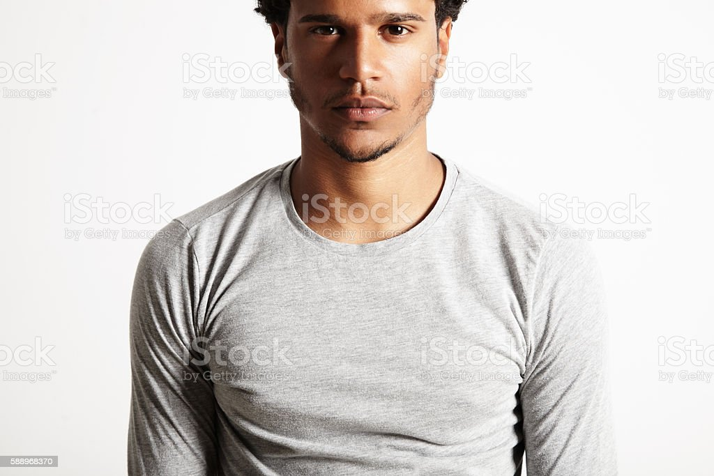 Young sexy black model wearing light gray longsleeve t-shirt stock photo