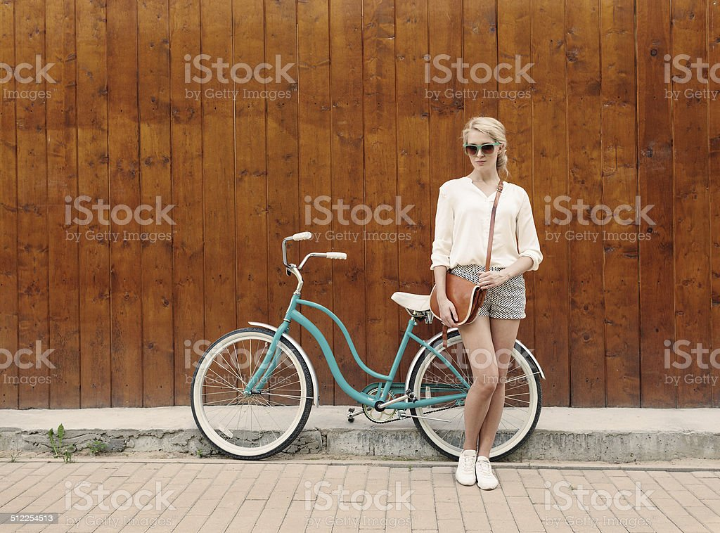 Young sexy blonde girl with long hair in green sunglasses stock photo