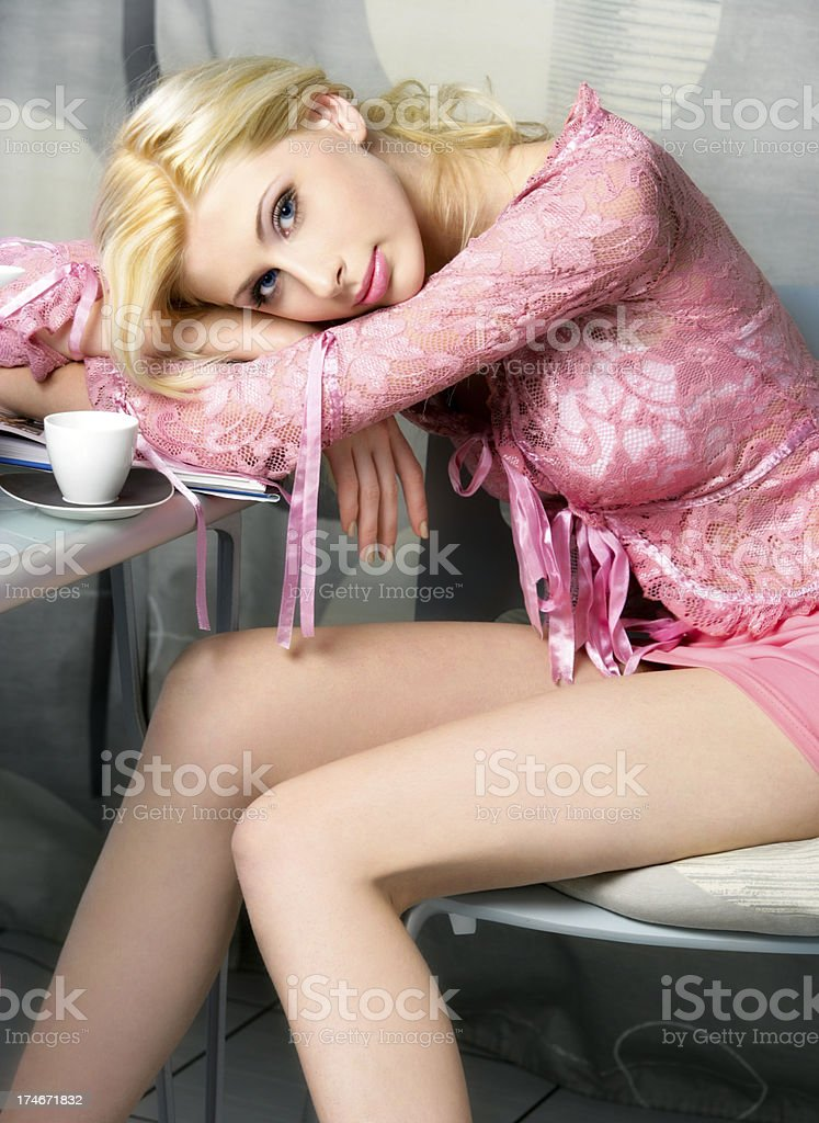 Young sexy blonde with cup of coffee royalty-free stock photo