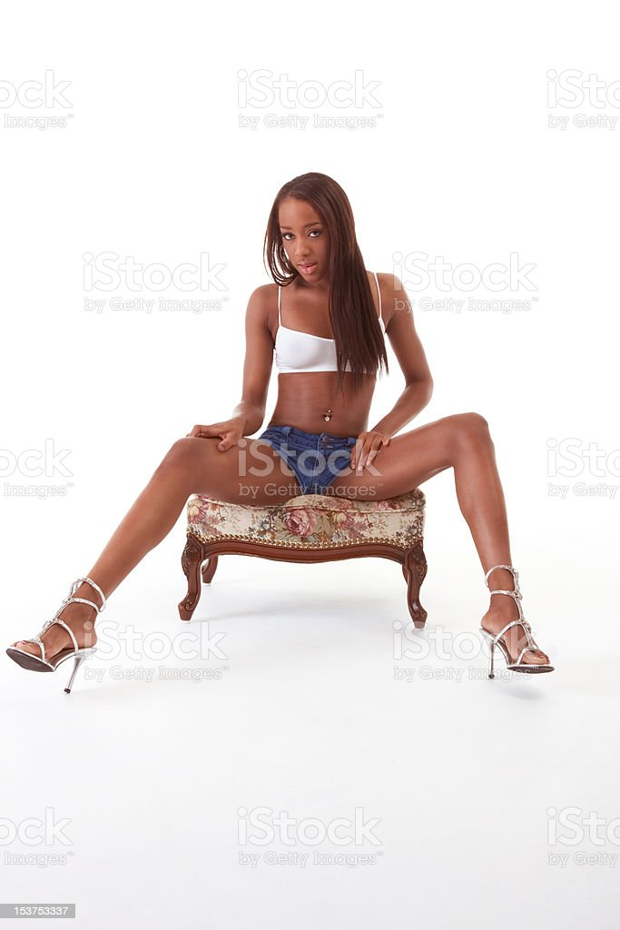 Young sexy ethnic black African-American woman in denim shorts royalty-free stock photo