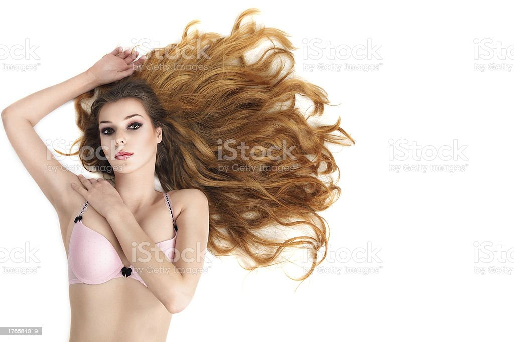 Young sexy girl in lingerie with long beautiful hair royalty-free stock photo