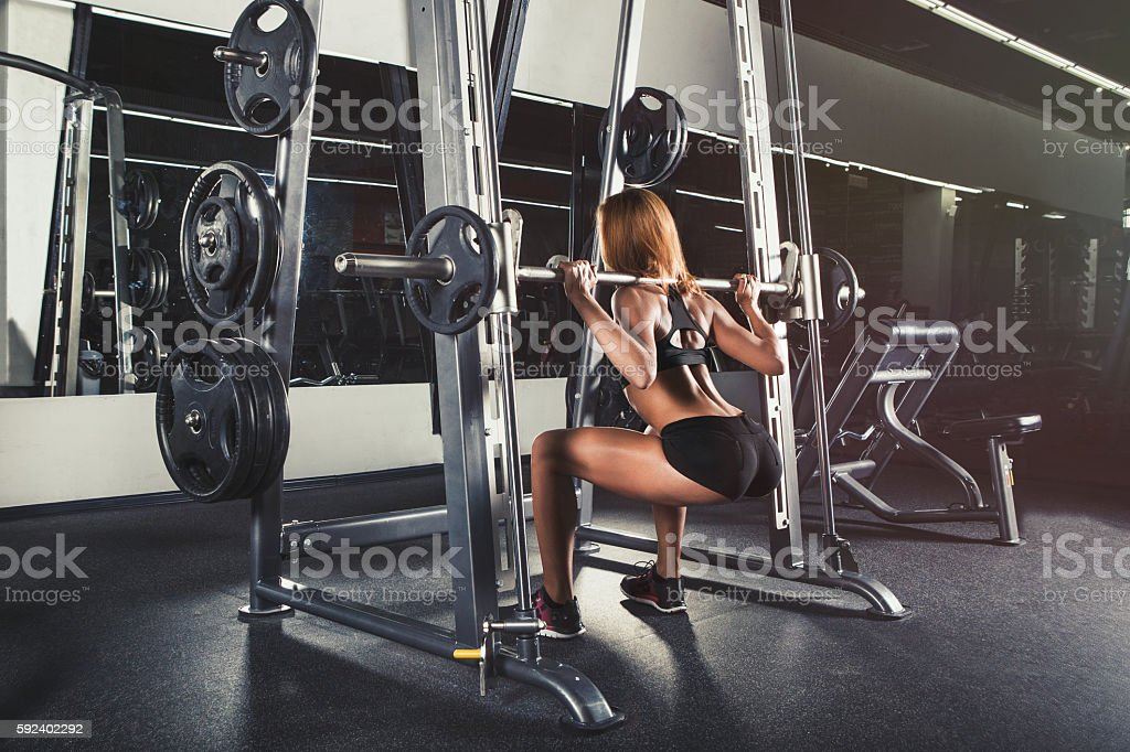 Young sexy girl in the gym stock photo