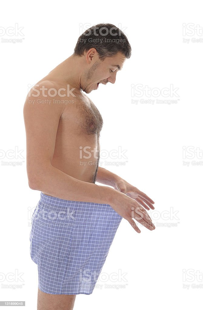 Young sexy handsome man looking in his pants royalty-free stock photo