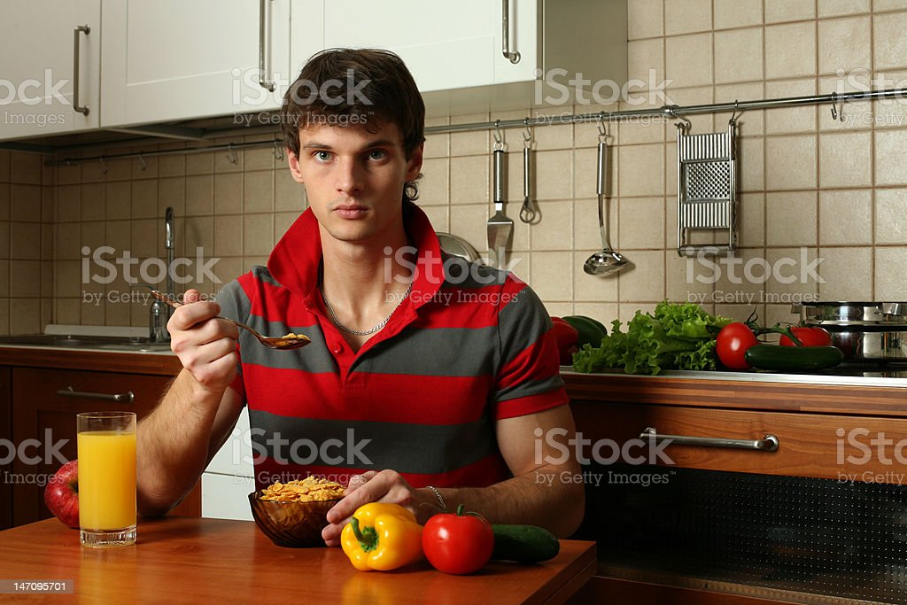Young Sexy Man Eating His Breakfast royalty-free stock photo