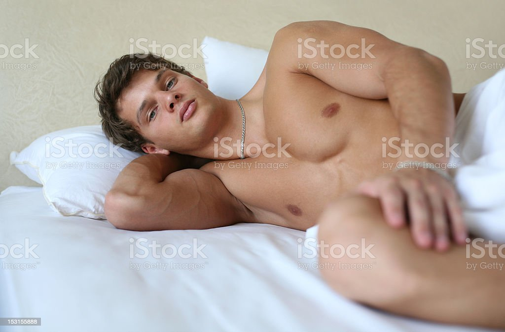 Young Sexy Man on a Bed royalty-free stock photo