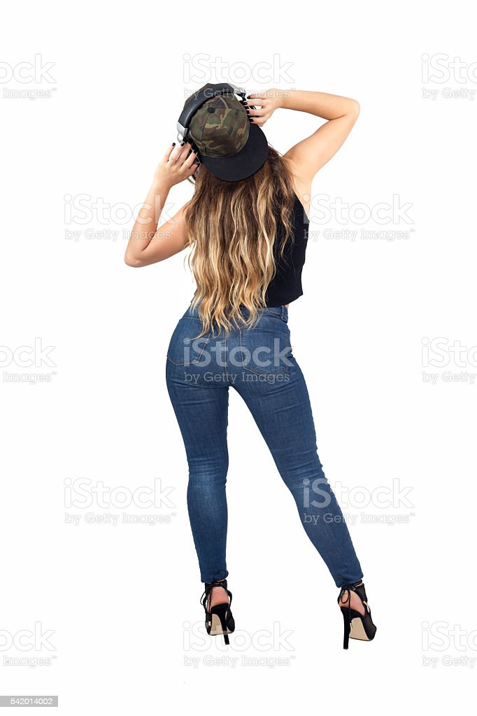 Young sexy woman listen music in studio stock photo