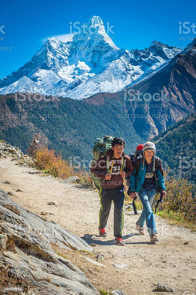 Young Sherpa men on Everest Base Camp trail Himalayas Nepal stock photo