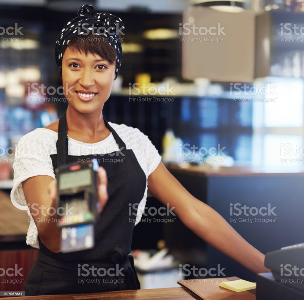 Young shop owner requesting payment stock photo
