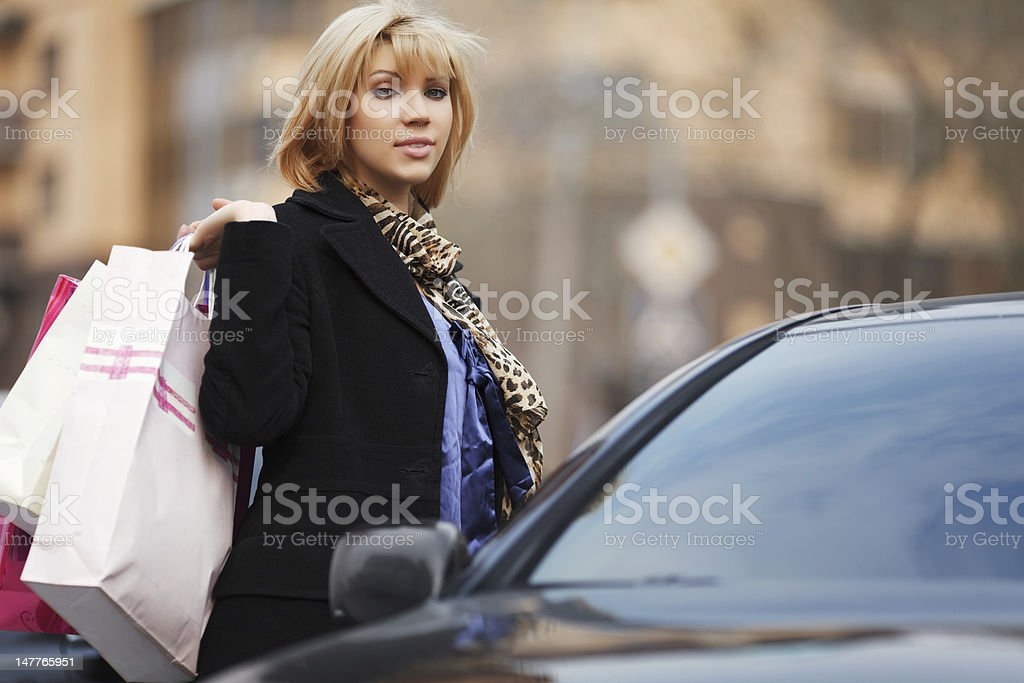 Young shopper with a car royalty-free stock photo