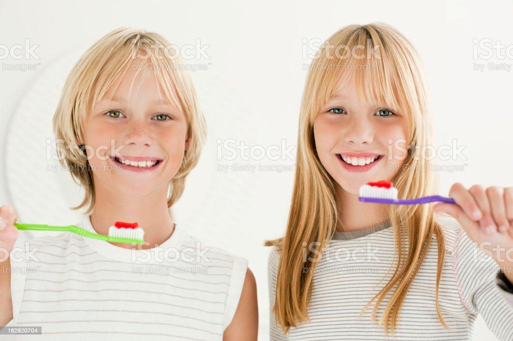 Young Siblings Brushing Teeth royalty-free stock photo