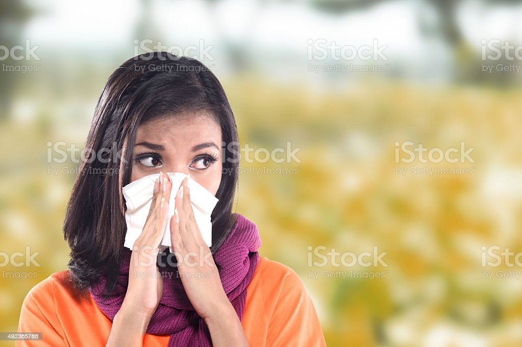 Young sick woman having cold stock photo