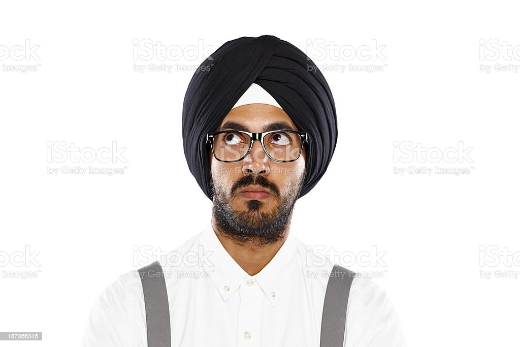 Young sikh man looking up at copyspace royalty-free stock photo