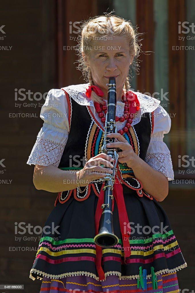 Young singer girl at clarinet from Poland in traditional costume stock photo