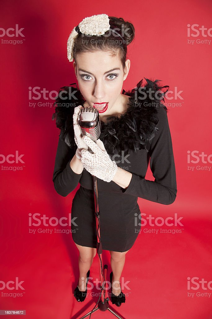 Young singer with vintage microphone royalty-free stock photo