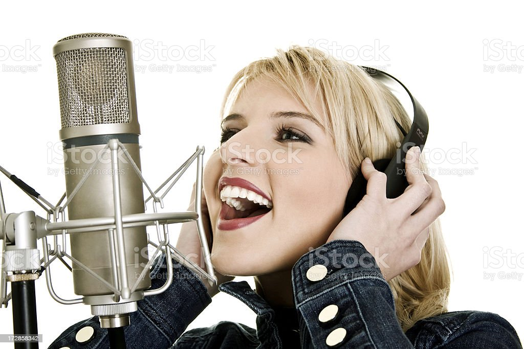 Young singing woman with microphone royalty-free stock photo