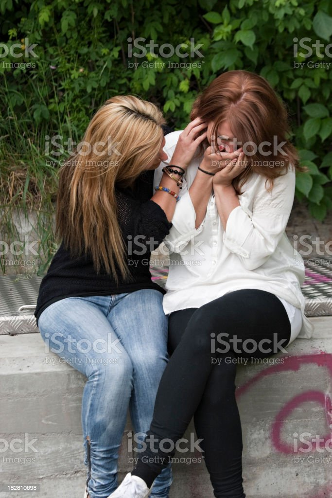 Young sister trying to console royalty-free stock photo