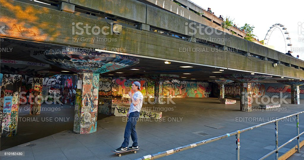Young skateboarder in London South Bank Skatepark stock photo