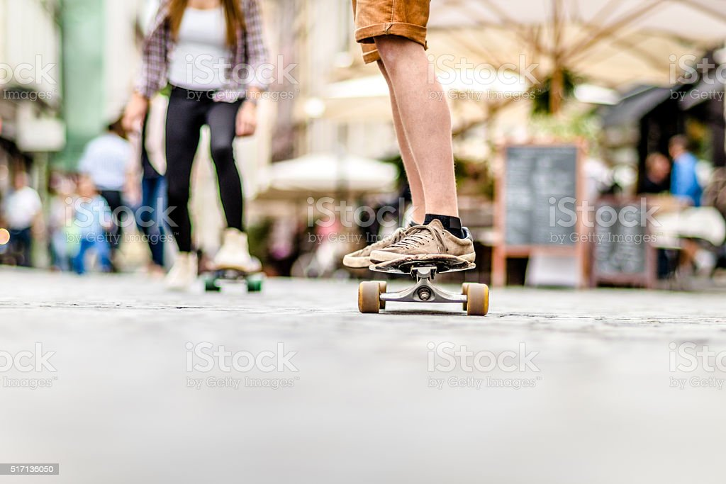 Young skateboarding couple stock photo