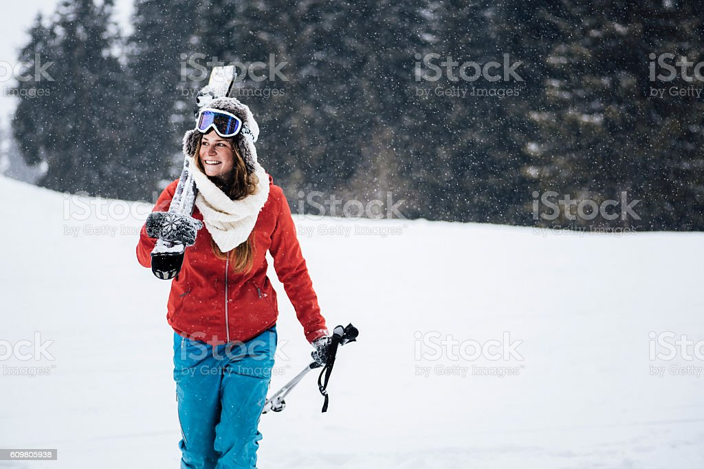Young skier enjoying the snowy scenery stock photo