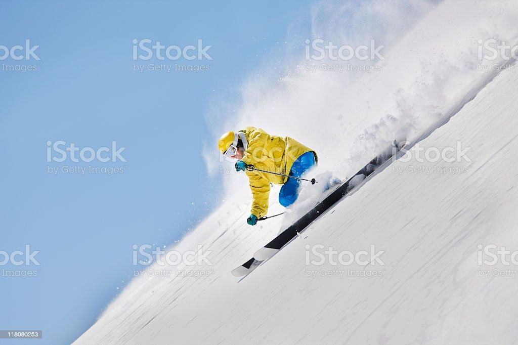 Young Skier Making Downhill Run stock photo