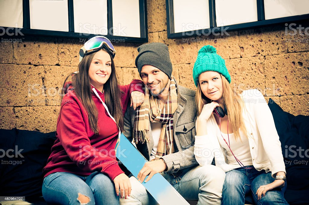 young skiers sitting on couch royalty-free stock photo