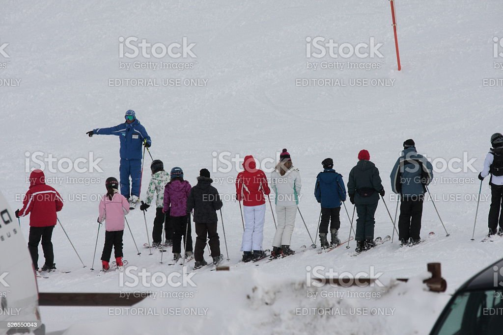 Young skiers with a ski instructor stock photo