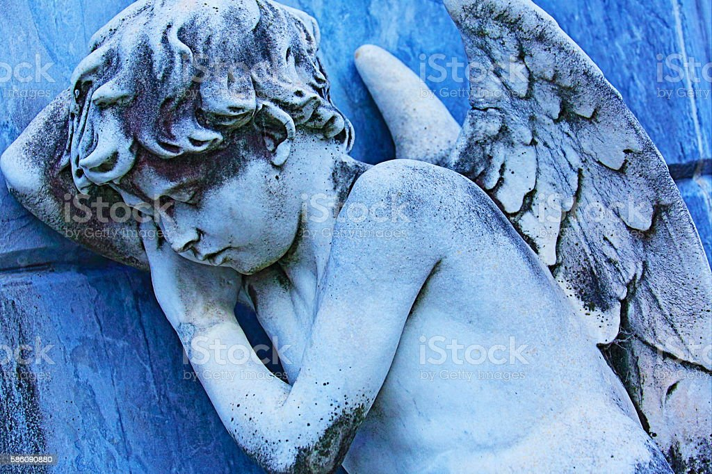 Young sleeping, sad and fragile Angel , Recoleta cemetery, Buenos Aires stock photo