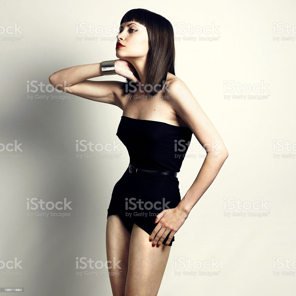 Young slender woman in fashionable swimsuit royalty-free stock photo