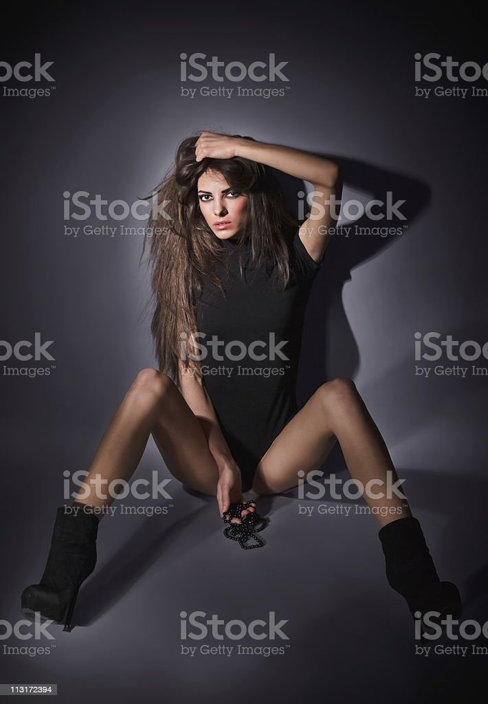 Young slim glamour lady with long hairs dressed in black stock photo