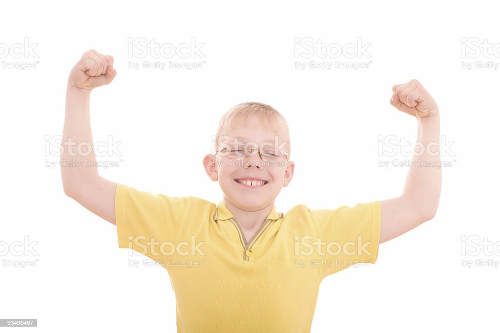 Young smiling boy flexes his muscles royalty-free stock photo