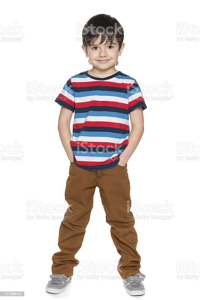 Young smiling boy in striped shirt stock photo