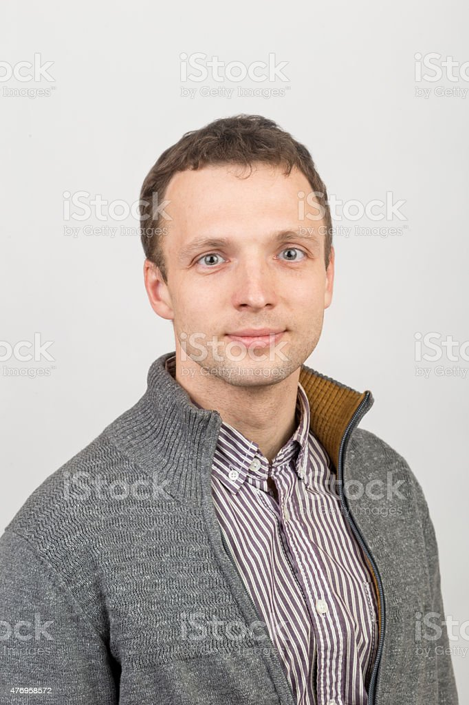 Young smiling Caucasian man in casual clothing stock photo
