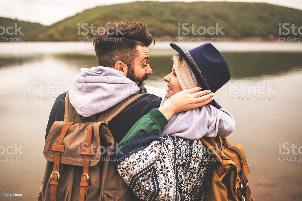 Young smiling couple enjoying nature and their hiking together royalty-free stock photo