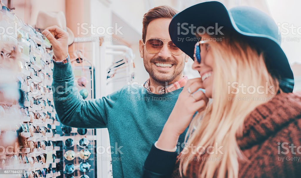 Young smiling couple shopping together stock photo