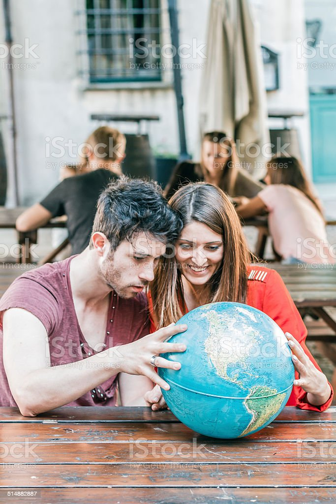 Young Smiling Couple with a Globe stock photo