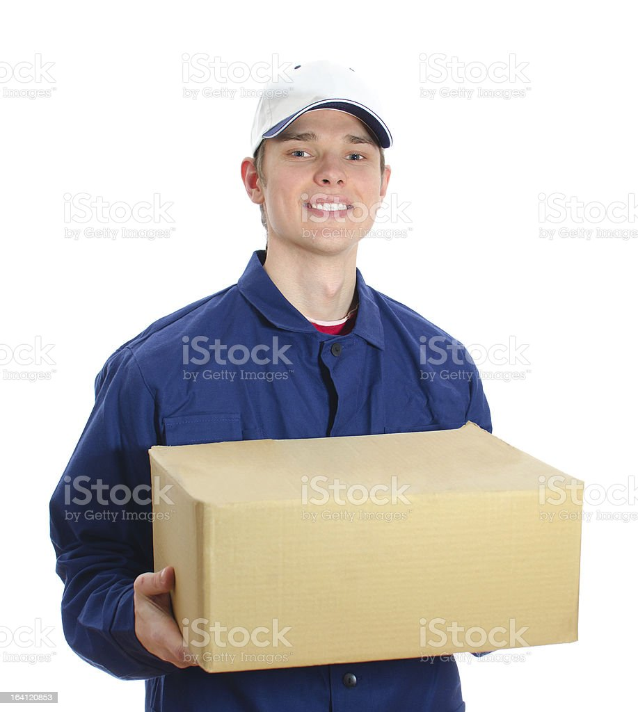 Young smiling courier holding cardboard box. Isolated on white royalty-free stock photo