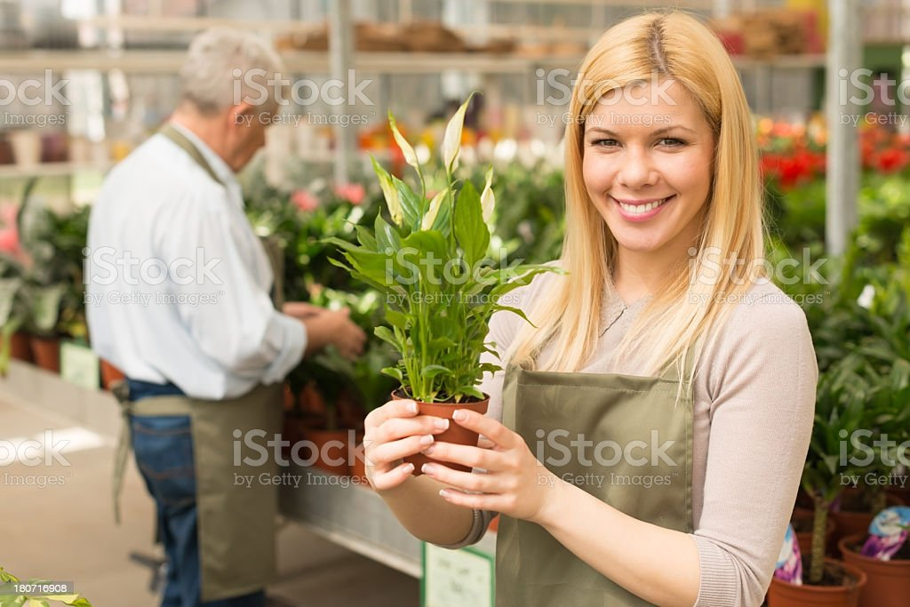 Young smiling female florist royalty-free stock photo