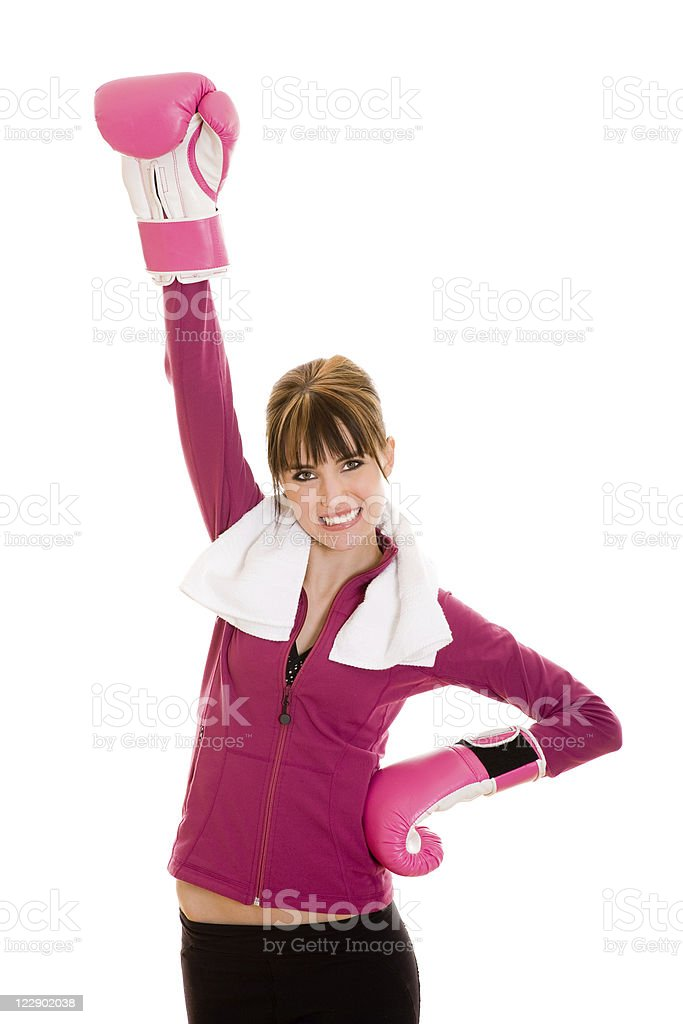 Young smiling female with pink boxing gloves royalty-free stock photo