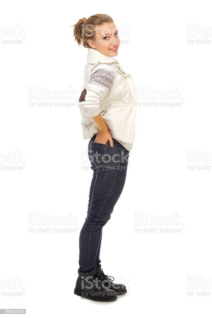 Young smiling girl in jeans royalty-free stock photo