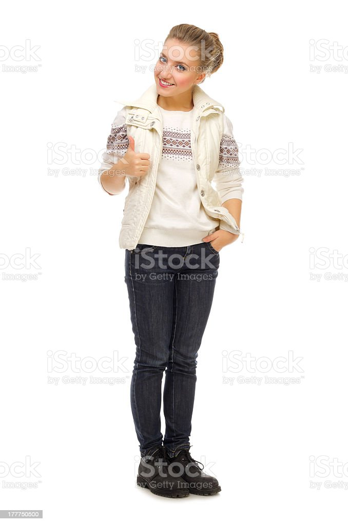 Young smiling girl shows ok gesture royalty-free stock photo