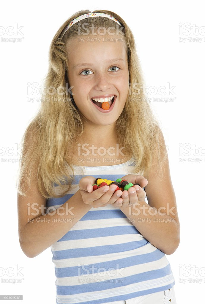 Young smiling girl with color chocolate candy royalty-free stock photo